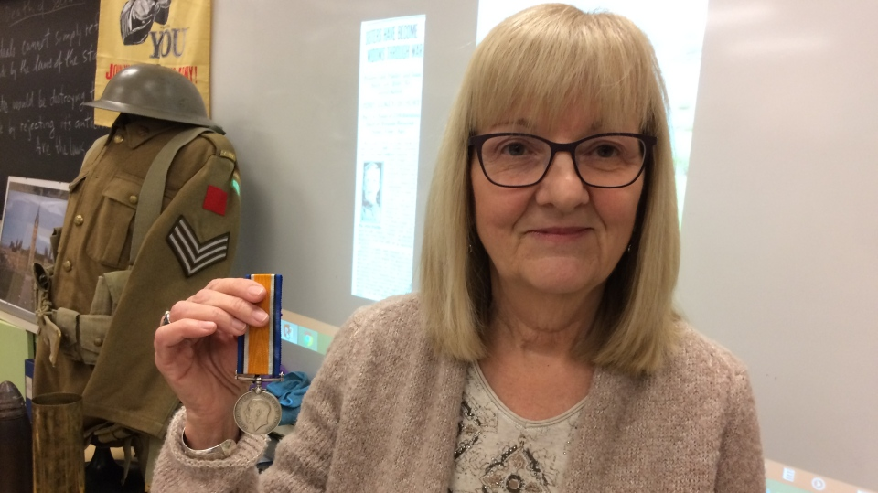 Patricia Pincock holds the long lost medal of her great grandfather John Hadley in Barrie, Ont. on Wednesday, Dec. 6, 2017. (Rob Cooper/ CTV Barrie)