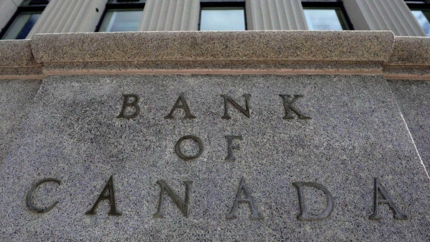 The Bank of Canada stuck with its trend-setting interest rate Wednesday -- but it offered fresh, yet cautious, warnings to Canadians that increases are likely on the way.