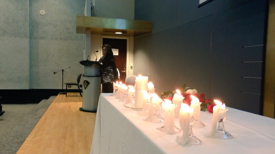 Candles were lit at OPP headquarters in Orillia, Ont. to honour the 14 women killed in the École Polytechnique massacre. (Krista Sharpe/ CTV Barrie)