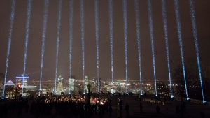 Fourteen beams of light shine toward the sky during a ceremony marking the 28th anniversary of the Montreal Massacre. THE CANADIAN PRESS/Ryan Remiorz