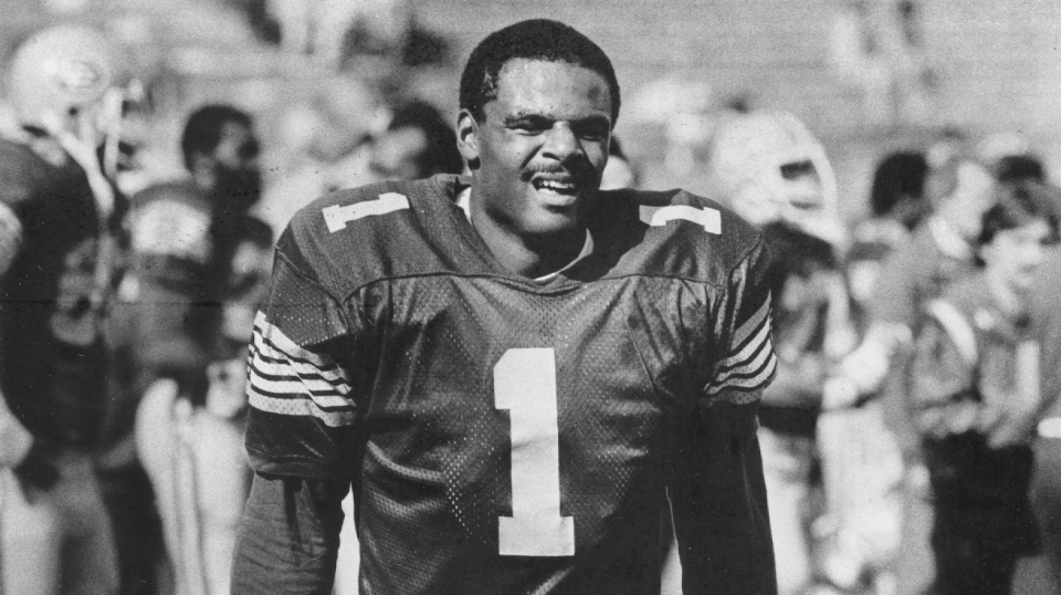 Edmonton Eskimos quarterback Warren Moon walks on the sidelines during CFL West Division semifinal footballl action against the Winnipeg Blue Bombers in Edmonton on November 13, 1983. (THE CANADIAN PRESS/Dave Buston)
