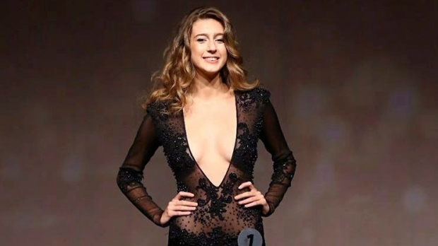 In this photo taken on Thursday, Sept. 21, 2017, Itir Esen, 18, poses in front of the contest jury for Miss Turkey 2017 in Istanbul. (AP Photo)