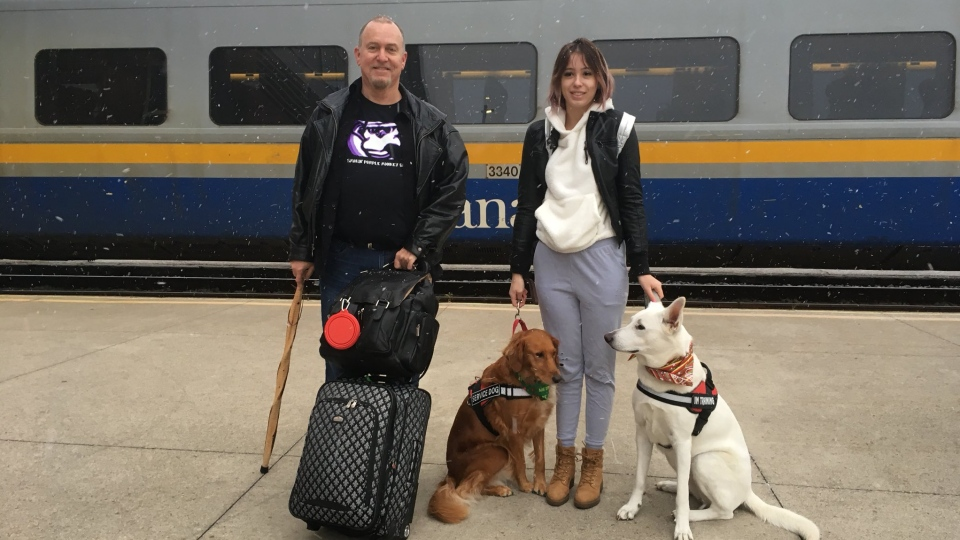 Emily Sadowski, her father Mark and two dogs head to Toronto on the Via Rail train in Windsor, Ont., Thursday, Dec. 7, 2017. (Chris Campbell / CTV Windsor)