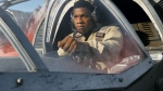 "This image released by Lucasfilm shows John Boyega as Finn in a scene from, ""Star Wars: The Last Jedi"" (Lucasfilm via AP)"