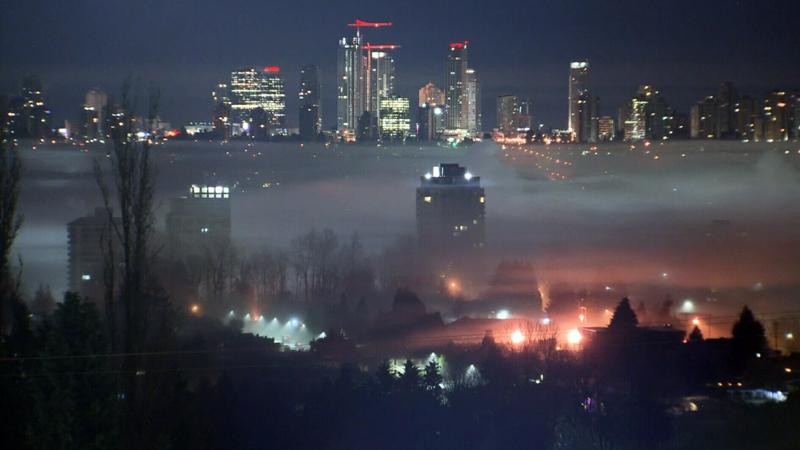 Heavy fog blankets the Vancouver skyline on Thursday, Dec. 7, 2017.