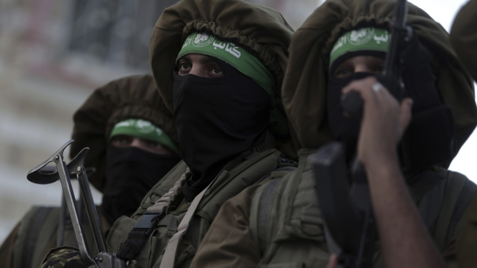 Masked Hamas gunmen attend a rally in Beit Hanoun, northern Gaza Strip, on Dec. 7, 2017. (Khalil Hamra / AP)