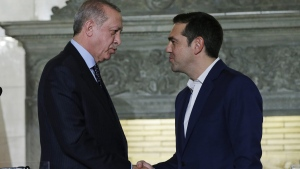 Tsipras, right, shakes hands with Erdogan