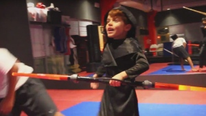 Savino Quatela is shown demonstrating his 'Star Wars'-inspired martial arts skills in this image from a video recorded when he was six years old. (YouTube / Savino Quatela)