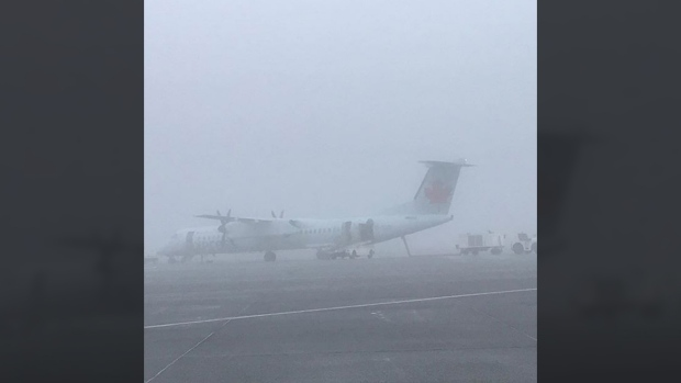 A plane is shrouded in dense fog at Victoria's airport. Dec. 7, 2017. (Instagram.com/YYJAirport)