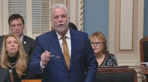 Philippe Couillard addresses the National Assembly in the English language on Dec. 7, 2017