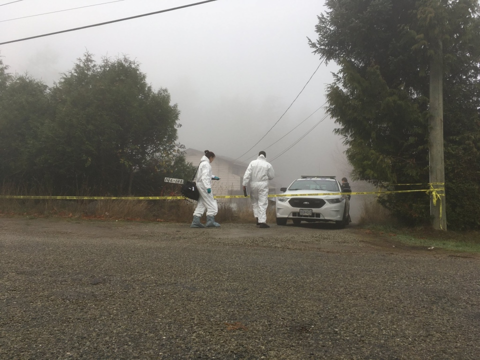 There was a heavy police presence at the home, which remained behind police tape Thursday. Dec. 7, 2017. (CTV Vancouver Island)