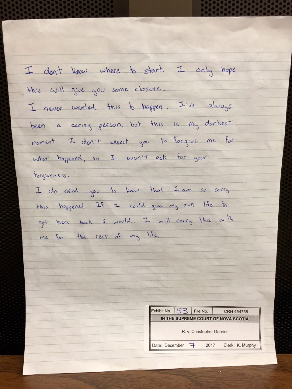 Christopher Garnier wrote a letter, shown here, to Catherine Campbell's family during an interview with police hours after he was arrested in the off-duty police officer's death. (THE CANADIAN PRESS/HO-Nova Scotia Supreme Court)