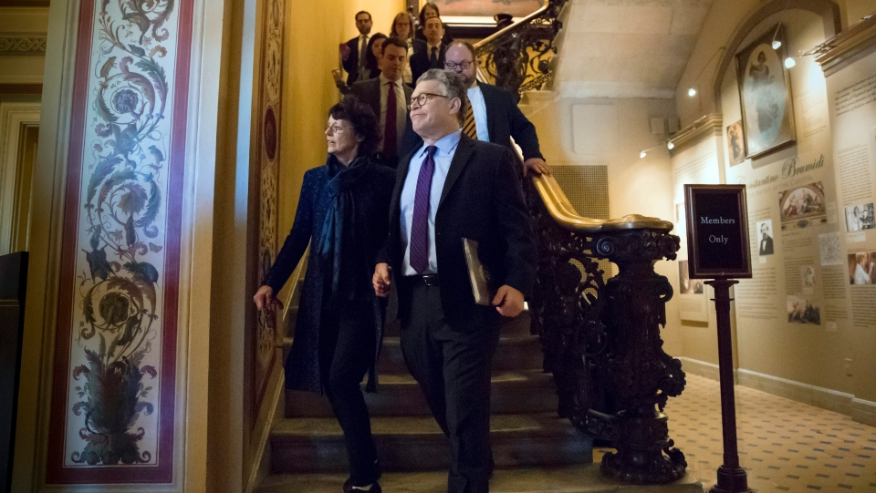 Sen. Al Franken, D-Minn., with his wife Franni Bryson, leaves the Capitol after a speech on the Senate floor saying he'll step down in the coming weeks due to mounting allegations of sexual misconduct, in Washington, Thursday, Dec. 7, 2017. (AP Photo/J. Scott Applewhite)