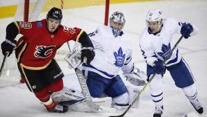 Calgary Flames' Matthew Tkachuk, left