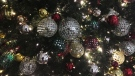 In this Friday, Dec. 1, 2017, photo, ornaments hang on a Christmas tree on display in New York.  (AP Photo/Swayne B. Hall)