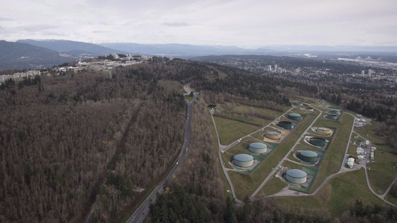 Kinder Morgan Trans Mountain Expansion Project's oil storage tank farm, at right with green tanks, is seen in Burnaby, B.C., on Friday, Nov. 25, 2016. THE CANADIAN PRESS/Jonathan Hayward