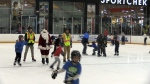 Santa laces up for a free skate in Cambridge