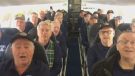Passengers on a recent flight out of Cape Breton were treated to a musical performance by one of the island's most celebrated choirs. (Lisa Belisle/Facebook)