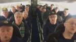 Song erupted on a Halifax-bound flight late last month after a flight attendant noticed The Men of the Deeps seated in the rear of the plane. (Lisa Belisle/Facebook)