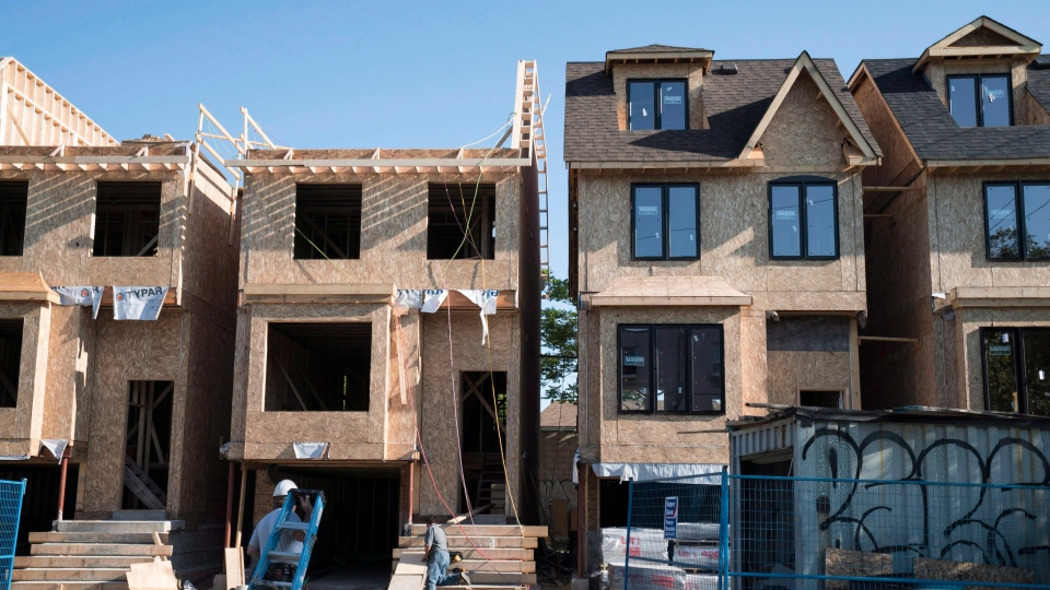 Houses under construction in Toronto are shown in this Friday, June 26, 2015 file photo. (File/THE CANADIAN PRESS)