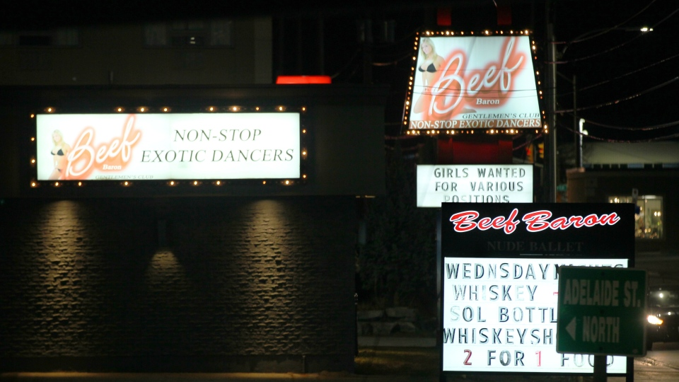 Signs for The Beef Baron Gentleman's Club light up the night in London, Ontario on Thursday Dec. 7, 2017. The city's sex workers and local advocates are slamming politicians over a bylaw that bans touching in London strip clubs. THE CANADIAN PRESS/Dave Chidley