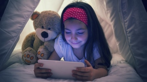 Children who use electronic devices before bed are more likely to sleep less and have a higher BMI, according to new research. (gordana jovanovic/Istock.com)