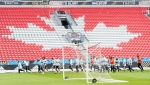 Seattle Sounders players warms up during practice ahead of the MLS Cup finals against the Toronto FC in Toronto on Friday, Dec. 8, 2017. THE CANADIAN PRESS/Nathan Denette