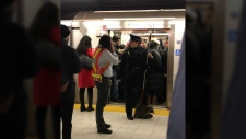 The small raccoon was captured by TTC staff at Bloor Station on Friday morning. (Dimitry G/Twitter)