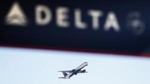 In this Jan. 30, 2017, file photo, a Delta Air Lines flight takes off from Hartsfield-Jackson Atlanta International Airport in Atlanta. (AP Photo/David Goldman, File)