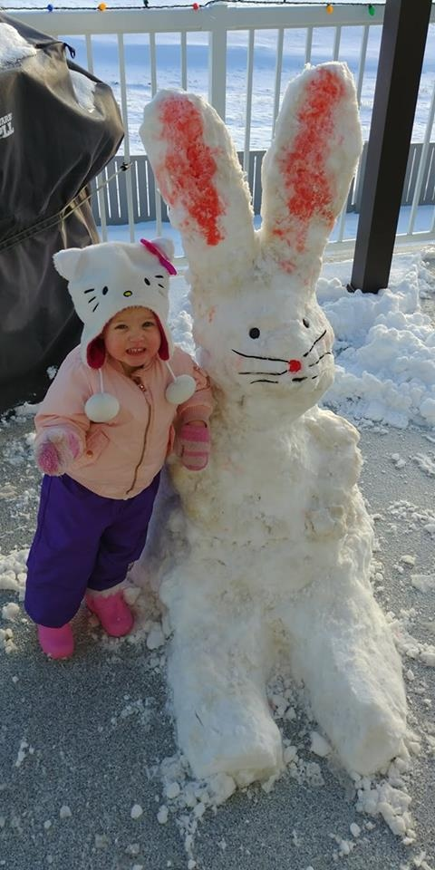 """""""Our little granddaughter Sloan with her snow bunny."""" (Wendy Sander)"""