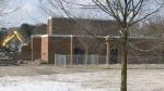 Former elementary school meets wrecking ball