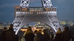 "The words ""Thank you Johnny"" is displayed on the Eiffel Tower referring to late French rock star Johnny Hallyday in Paris, France, Friday, Dec. 8, 2017. (AP / Michel Euler)"