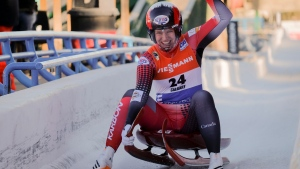 Canada's Alex Gough, celebrates her second place finish in the women's World Cup luge competition in Calgary, Saturday, Dec. 9, 2017. (THE CANADIAN PRESS / Jeff McIntosh)
