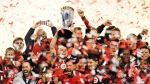 Toronto FC midfielder Michael Bradley raises the trophy as Toronto FC celebrates their victory over the Seattle Sounders in MLS Cup Final soccer action in Toronto on Saturday, December 9, 2017. (THE CANADIAN PRESS / Frank Gunn)