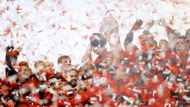 Toronto FC captain Michael Bradley hoists the trophy as the Toronto FC celebrate their win over the Seattle Sounders in the MLS Cup Final in Toronto on Saturday, December 9, 2017. (THE CANADIAN PRESS / Mark Blinch)