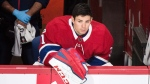 Montreal Canadiens goaltender Carey Price looks on from the bench during second period NHL hockey action against the Edmonton Oilers in Montreal, Saturday, December 9, 2017. THE CANADIAN PRESS/Graham Hughes