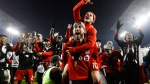 Toronto FC Sebastian Giovinco jumps on Jonathan Osorio after defeating the Seattle Sounders to win the MLS Cup in Toronto on Saturday, Dec. 9, 2017. (Mark Blinch/THE CANADIAN PRESS)