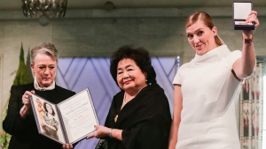 Winners of the Nobel Peace Prize 2017, representatives of the International Campaign to Abolish Nuclear Weapons (ICAN), with leader of the Nobel committee Berit Reiss-Andersen, left, Hiroshima Survivor Setsuko Thurlow and leader of ICAN Beatrice Fihn in the City Hall Oslo, Norway, Sunday Dec. 10, 2017. (Berit Roald/ NTB scanpix via AP)