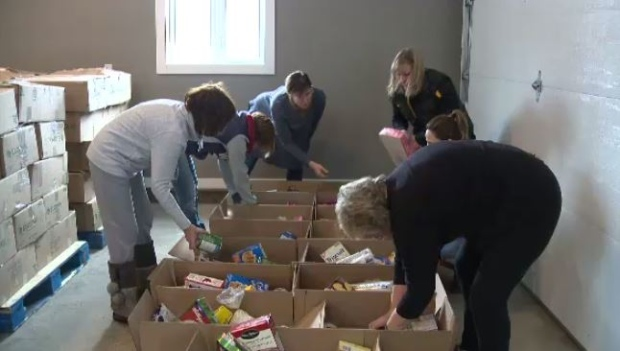 Volunteers are working hard to prepare 110 food-filled hampers to be sent to Churchill, Man., for the holidays. (CTV Winnipeg)