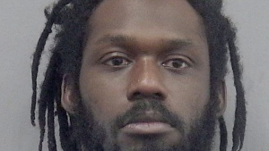 This undated photo provided by the Gainsville, Fla., Police Department shows WWE wrestler Rich Swann. (Gainesville Police Department via AP)