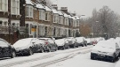 A residential street scene in Stoke Newington, England, after heavy snow blanketed the region, Sunday morning Dec. 10, 2017. Snow is causing travel disruptions across central England and northern Wales, Sunday, grounding flights and shutting down roads.(AP Photo/Rebecca Horsbrugh)
