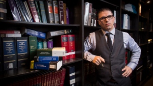 Lawyer Adam Savaglio poses in the offices of Scarfing Hawkins LLP in Hamilton, Ont., on Thursday, December 7, 2017. Savaglio is representing a woman (who doesn't want to be identified) who filed a human rights complaint after being sexually assaulted. (THE CANADIAN PRESS / Peter Power)