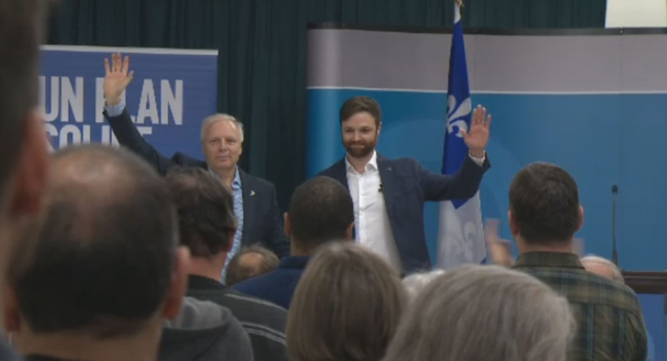 Parti Quebecois leader Jean-Francois Lisee introduces the party's candidate for the Gouin riding in next year's elections, Olivier Gignac, on Dec. 10, 2017.