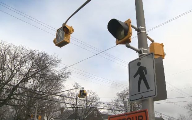 Halifax Regional Police have charged a woman after she hit a pedestrian at a crosswalk Friday evening.