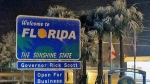 The 'Welcome to Florida' sign in the northwest part of the state was covered in light snow. (Photo: NorthEscambia.com)