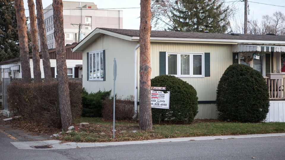 A home with a for sale sign stands in the Twin Pines Mobile Home Park in Mississauga, Ont., on Friday, December 8, 2017. Residents are fighting a move by The Peel Housing Corporation to impose a re-development plan for the community. THE CANADIAN PRESS/Chris Young