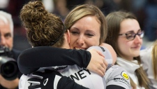 Skip Rachel Homan, from Ottawa, Ont. hugs second Joanne Courtney following their 6-5 win over Team Carey at the Olympic curling trials Sunday December 10, 2017 in Ottawa. (THE CANADIAN PRESS/Adrian Wyld)