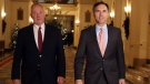 Federal Finance Minister Bill Morneau, right, and Parliamentary Secretary to the Minister of Justice Bill Blair make their way to talk to reporters before joining their federal, provincial and territorial counterparts for dinner in Ottawa, Sunday, December 10, 2017. THE CANADIAN PRESS/Fred Chartrand