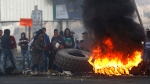 Palestinians burn tires during clashes with Israeli troops following a protest against U.S. President Donald Trump's decision to recognize Jerusalemas the capital of Israel, in the West Bank City of Nablus, Sunday, Dec. 10, 2017. (AP Photo/Majdi Mohammed)