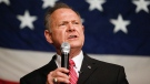 FILE- In this Dec. 5, 2017, file photo, former Alabama Chief Justice and U.S. Senate candidate Roy Moore speaks at a campaign rally in Fairhope Ala. As Alabama's high-profile Senate race heads toward a Tuesday vote, supporters and opponents Moore are bending the truth, or shattering it to pieces, in the campaign's final stretch. (AP Photo/Brynn Anderson, File)